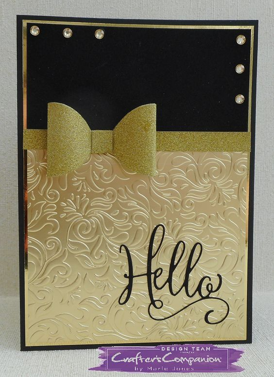 HSN. Card made using Sara Signature Black & Gold Collection - Royal Bow die, Hello die, Regal Swirls embossing folder, Luxury Glitter card & Luxury Mirror card. Designed by Marie Jones #crafterscompanion