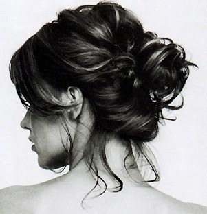 To create that messy look, pull your hair back into a mid pony tail and tease to top layers. Then twist the ponytail around itself and secure with a handband. Then grab some bobby pins and secure the loose ends. Take random sections of the bun and gently pull out to create that messy look. Make it even messier by teasing ...