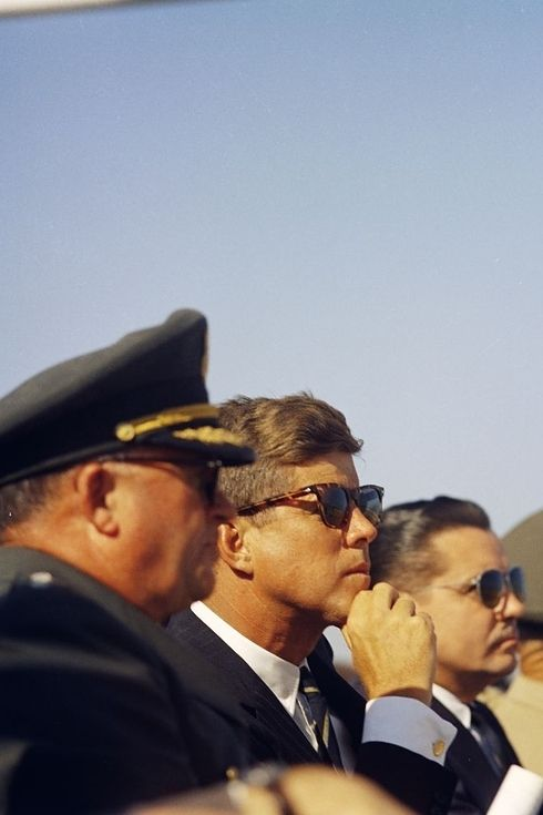 Kennedy watching a gigantic ordinance demonstration at Fort Bragg.