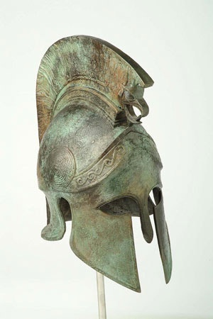 Macedonian Helmet  Height: 0.25 m  Weight: 11 kg  With griffin crest    Ancient Greek life size helmet from Macedonia of Alexander the Great.    It was made of Bronze circa 330 BC.