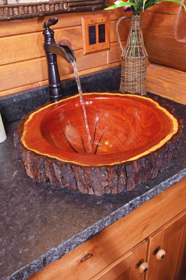FUNCTIONAL ART – This bathroom's custom wood sink is handcrafted.