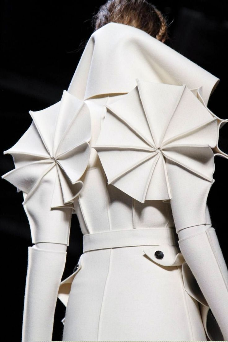 Wearable Art - dramatic white coat with manipulated fabrics & bold 3D