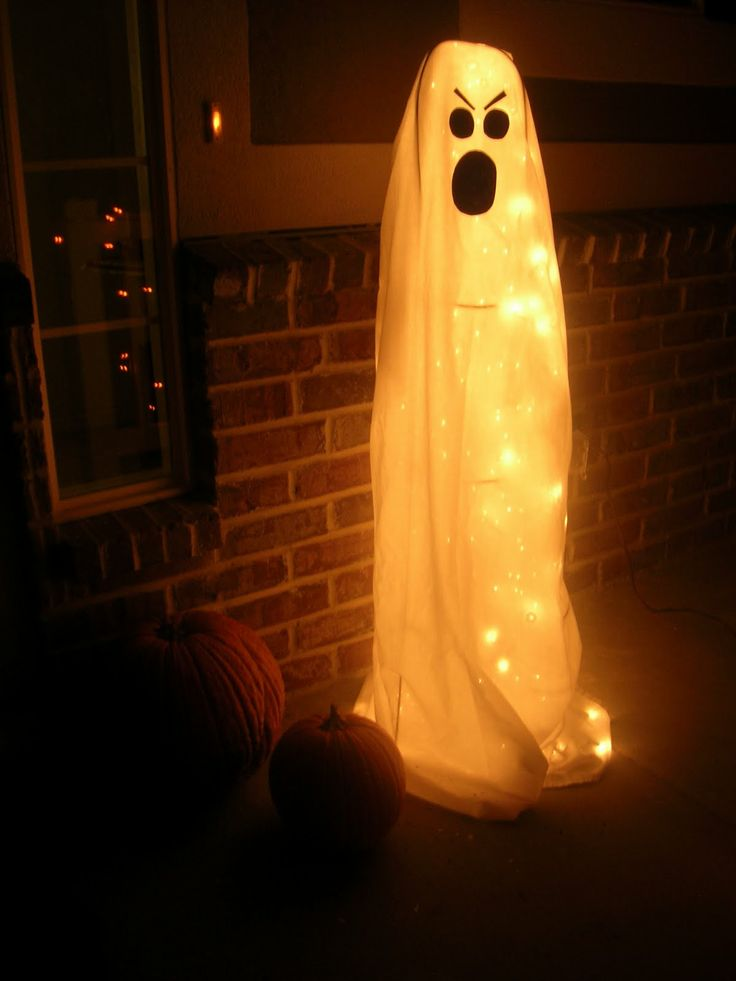 Halloween porch project - tomato cage, Christmas lights, sheet & ghost face