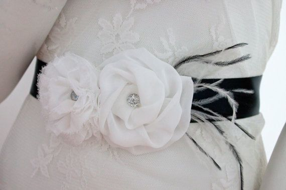 Satin ribbon wedding sash, with organza flowers and feather accents. The 2.5 and 3 inch flowers have a silver gem accent in the centre.  Satin