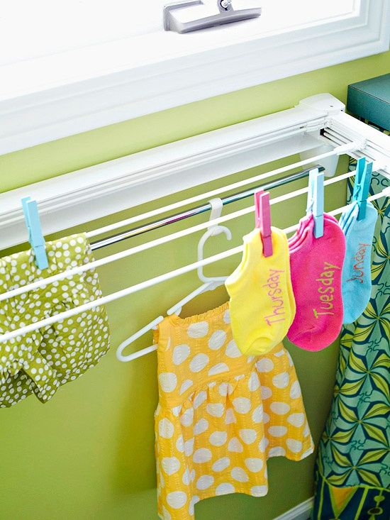 Organize This: Small Laundry Nooks Here is an other retractable option for hanging and drying clothes.  It saves valuable floor space by hanging on the wall.