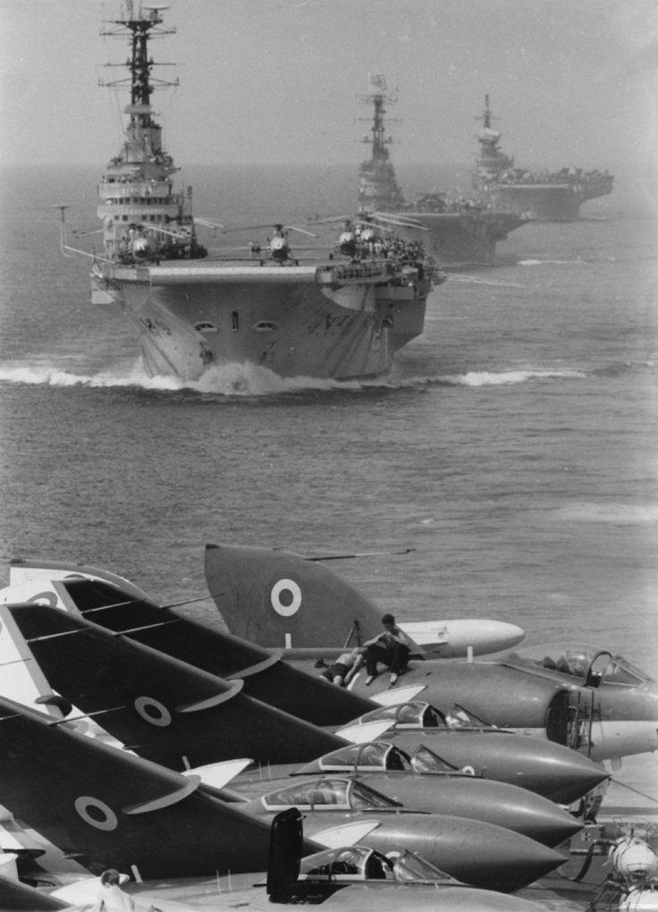 HMS Eagle, HMS Bulwark, HMAS Melbourne and HMS Victorious bringing up the rear.