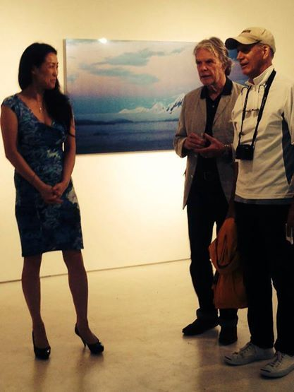 """Pictured is gallery Founder/ Director Nana Onishi greeting some guests at the """"Vanishing Horizons/ Expanding Visions"""" exhibit being shown in #NYC. 06.12.14-07.12.2014 (Photo credit: Onishi Project)"""