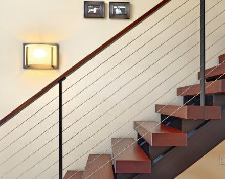 A Modern Floating Staircase And Thick Brazilian Cherry Wood Treads With  Sleek Stainless Steel Cable Railing