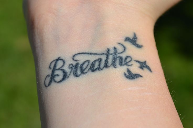 I always wanted to get this word somewhere on my body. I'm constantly worrying about some little thing. I need to remember to just slow down and to just breathe.