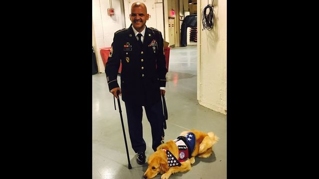 Army veteran surprised with service dog at halftime ceremony