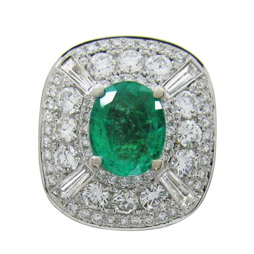 THE ADRIENNE RING  A custom designed ring with an Emerald centre stone and Diamonds.