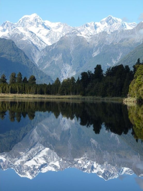 Mount Tasman and Mount Cook, Lake Matheson, New Zealand travel lakeside scenery