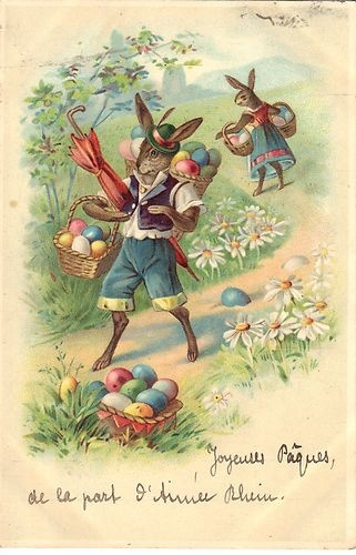 Vintage Easter postcard card with anthropomorphic rabbits on an Easter egg hunt.