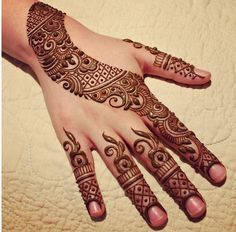 """I thought the way that this tattoo creates """"edges"""" through that sweeping """"stripe"""" across the hand and wrist was interesting."""