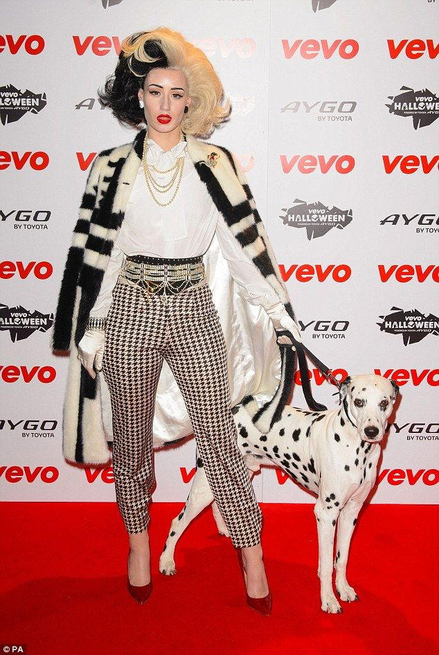 101 admirers: Iggy Azalea arrived at the Vevo Halloween Party, at the Oval Space, in East London looking sensational as Cruella de Vil