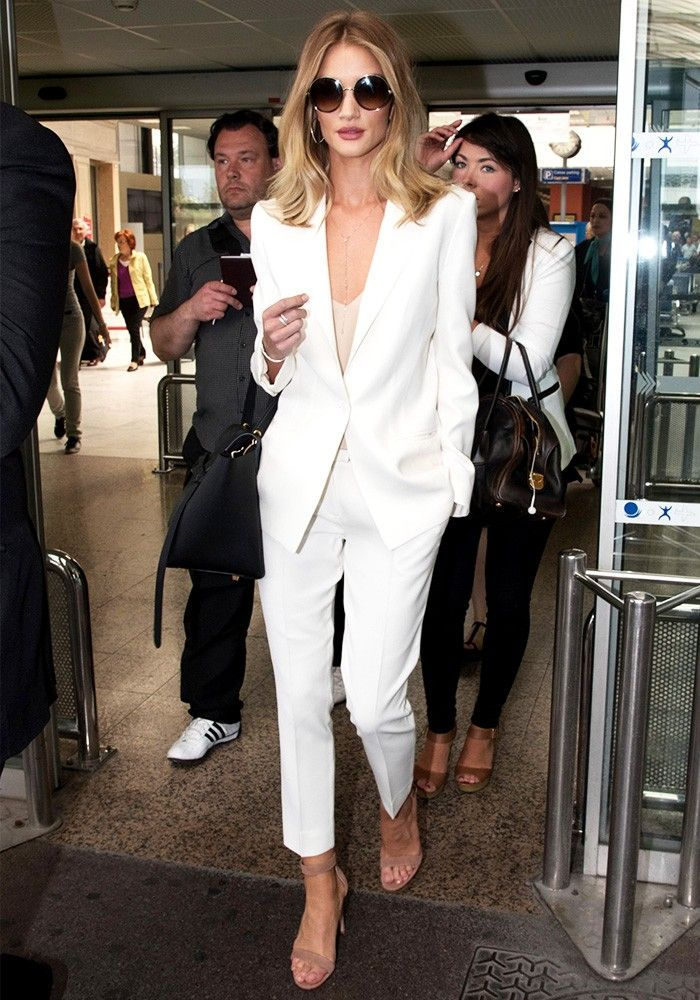 Rosie Huntington-Whiteley's All-White Outfit Defines Airport Chic via @WhoWhatWear