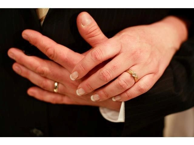 close up of the bride and grooms rings