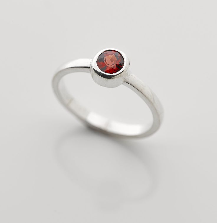 Small round Garnet set in a sterling silver band