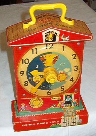 ****VINTAGE FISHER PRICE MUSIC BOX WIND-UP TEACHING CLOCK****. My kids played with one of these in the late 60s and mid 70s.