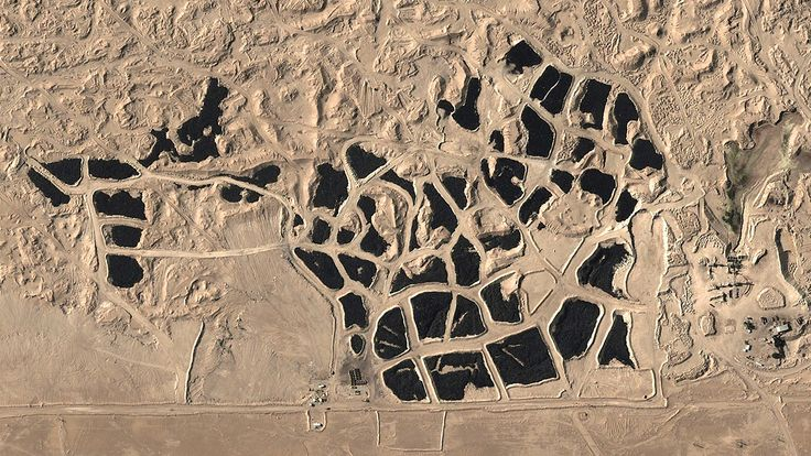 Beautiful, Troubling Photos Show Our Planet as Astronauts See It | Tire Graveyard, Sulaibiya, Kuwait City, Kuwait   Benjamin Grant/DigitalGlobe  | WIRED.com