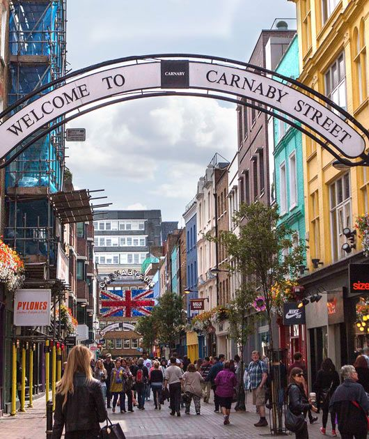 """Best known for being the epicentre of """"Swinging London"""" in the 1960s, Carnaby Street has long been a home for urban bohemians, from the Mods in the Sixties, to the punks of the Seventies and Eighties. Still a bustling centre of fashion and culture, Carnaby Street today plays host to some of the most stylish boutiques, cafés and bars in London."""