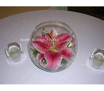 """Simple centerpiece with Stargazer Lily floating in 6"""" rose bowl. But red."""