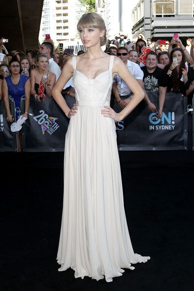 Taylor Swift Evening Dress - Taylor Swift looked like a goddess at the ARIA Awards in this flowing white gown. Perfection!  Brand:  Elie Saab