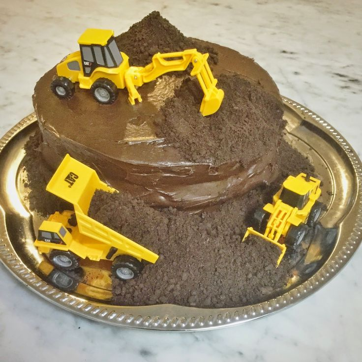 Construction vehicle cake for a construction-themed birthday party.  See more photos, décor and DIY project details from this party at www.fabeveryday.com.