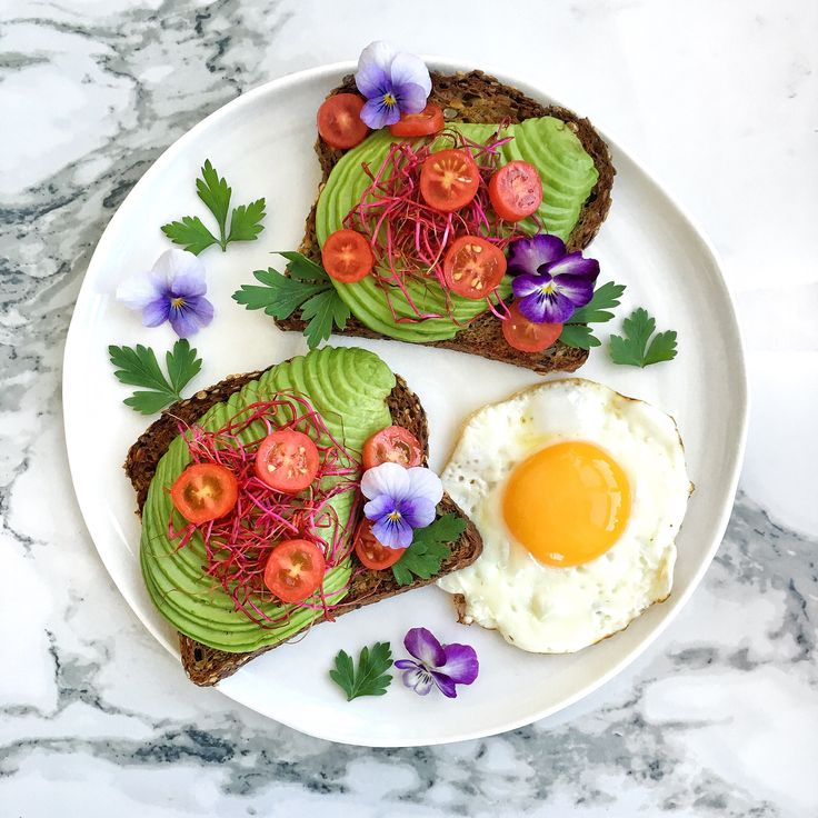 Avocado toast, beetroot sprouts, , cherry tomatoes, parsley and edible flowers
