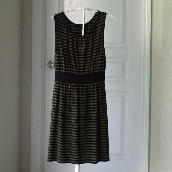 EXPRESS dress/tunic Black with gold metallic stripes. nwot Bundle with black and gold shoes to save. Express Dresses