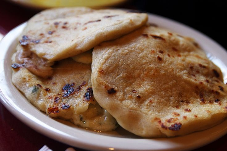 If you're going to #travel to El Salvador, don't miss the local traditional #food. These are Pupusas, fried cakes filled with cheese or chicken. Image courtesy of roboppy: http://www.flickr.com/photos/roboppy/2100226700/