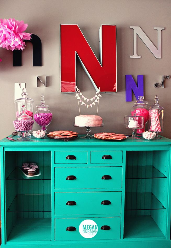 Sounds simple enough... Remove some drawers, add glass shelves... love the letters too!