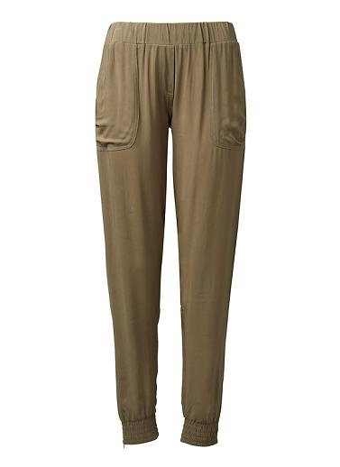 Viscose light-weight pant. Features elasticised waist with front tie, side slouchy pockets, elasticised hem cuff with exposed hem zip. Comfortable loose silhouette. Available in various colours.