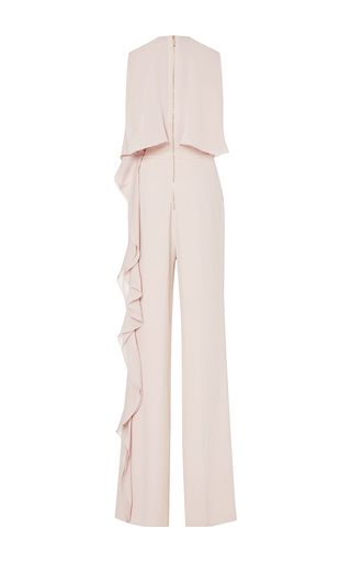 This sleeveless **Elie Saab** jumpsuit is rendered in crepe cady and double georgette and features a bi-level bodice with a cascading ruffle hem that extends along the fluid pant.