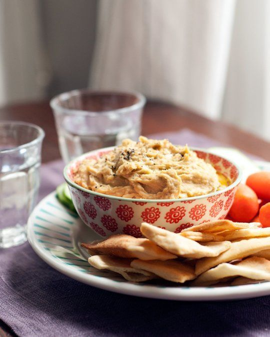 I'm fairly convinced that hummus is some of the best stuff on earth. It might look beige and boring in the bowl, but this blend of soft chickpeas, olive oil, tahini, lemon juice, and garlic creates a dip that is so much more than the sum of its parts. Skip the store bought stuff — making it yourself is so easy and will be far tastier than just about anything from the deli section.