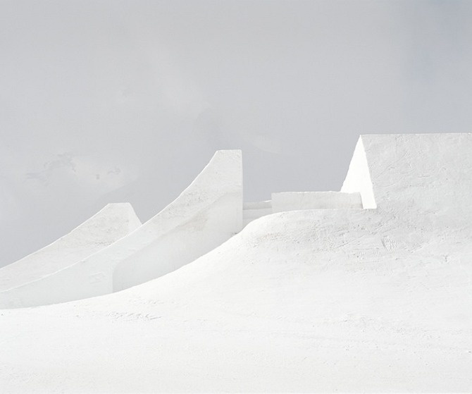 """Snowpark by Philippe Fragnière / """"The Snowpark project proposes an analysis of landscapes modified by human intervention. An undefined landscape, dotted by the presence of functional ephemeral objects, which acquire by the eye of the camera, an hybrid status halfway between architecture and sculpture. Although they are dedicated to a specific use and built without any sculptural intention, these structures suggest definite relationships with land art or minimalism."""""""