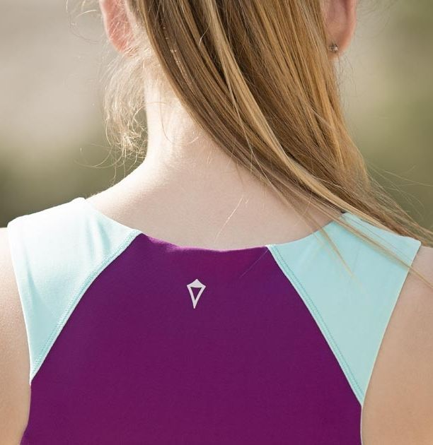 smooth Luxtreme™ fabric is sweat–wicking, four–way stretch to keep you cool and comfy in the hottest sweaty practices.  | Beam to Bars Tank