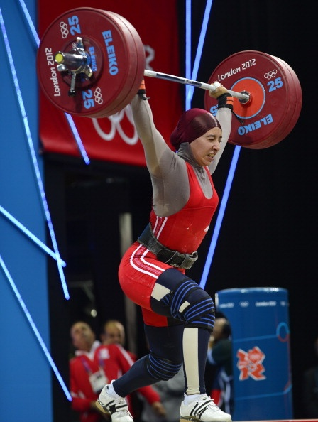 Ghada Hassine competes in the women's 69kg group B weightlifting event, at The Excel Centre in London on August 1, 2012 during the London 2012 Olympic Games. AFP PHOTO / YURI CORTEZ (Photo credit should read YURI CORTEZ/AFP/GettyImages)