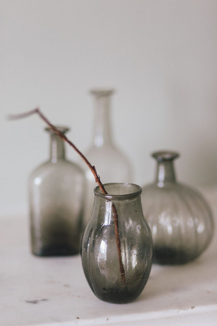 These lovely recycled glass bottles come in a variety of shapes. They look wonderful grouped together and are beautiful empty or can be used as vases. Sold as a set of 4.  £29.95