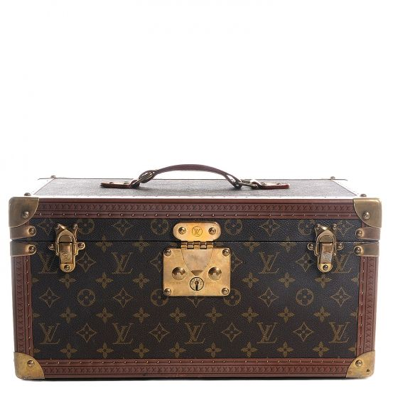 This is an authentic LOUIS VUITTON Monogram Boite Bouteilles et Glace Beauty Train Case.   This stunning hard train case is crafted of Louis Vuitton monogram on toile canvas.