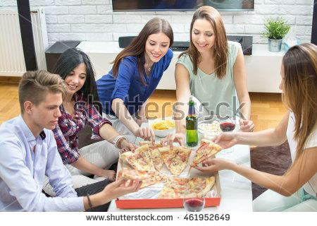 Group of young people eating pizza at home.