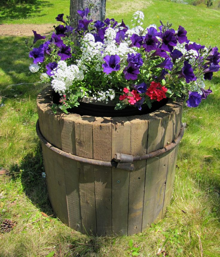 An old wooden culvert was cut in half and made into 2 flower pots. www.therusticsoul.tumblr.com