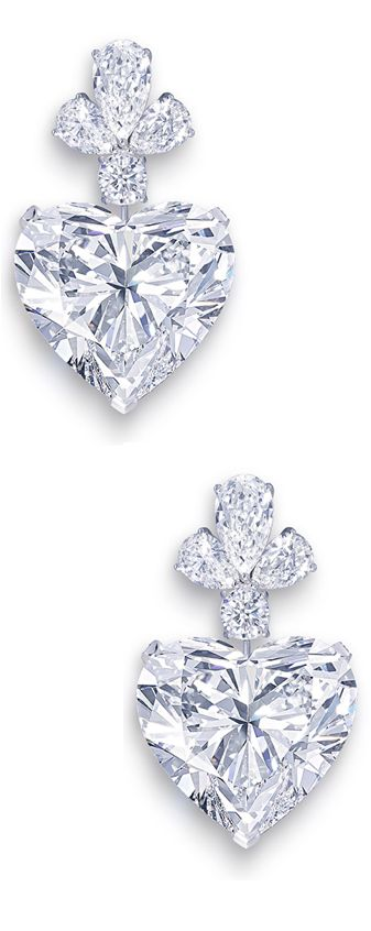 """The Graff """"Sweetheart"""" Earrings are set with two perfectly matching heart-shaped diamonds, each of which exceeds 50 carats (that's right - FIFTY carats each!)  (=)"""