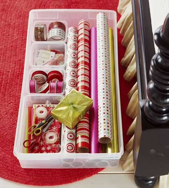 If you don't have a designated space for gift wrapping- Create this under the bed wrapping station by adding dividers to a basic plastic storage box. Decide which supplies you want in each section and add labels you can see from the outside. Fill the box and slide it under the bed