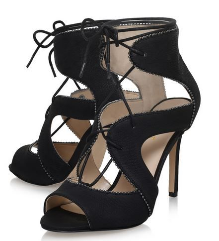 Elegance arrives in the form of Ulimah, a statement cage sandal from Nine  West. Set in classic black for versatile wear and timeless appeal, its lace- up ...