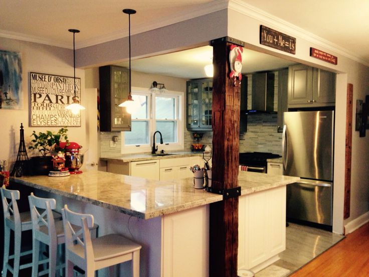 New ikea kitchen with granite counters and tile floors - barn board beams