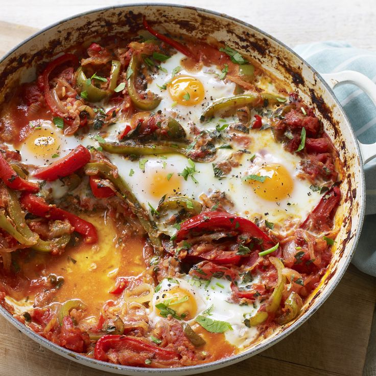 Shakshouka is a brunch that can cure any hangover! These Middle-Eastern baked eggs in spicy tomato sauce with peppers is a must-try.