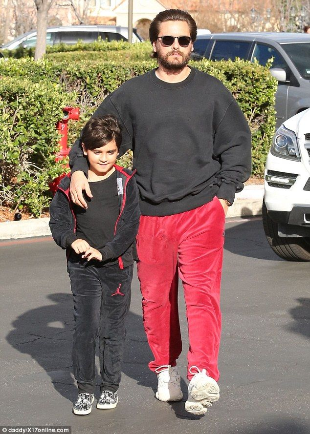 Scott Disick and son Mason sport matching tracksuits  Scott Disick spent some quality time with son Mason on Monday.  The father-son duo was dressed to match both sporting red and black athletic-wear while out to lunch together in Calabasas California.  The reality persona 34 wrapped an affectionate arm around his eight-year-old son while they made their way to the restaurant.  Boys will be boys! Scott Disick and son Mason wore color-coordinated looks while enjoying some quality time…