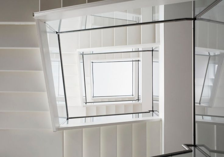 Large glass and steel staircase connects all five floors of this new build home in London.