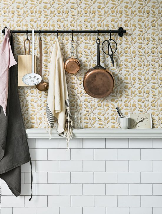 With an authentic block-printed look, this Rosehip patterned wallpaper by Morris & Co cleverly resembles a tiled wall, making it a fitting choice for a kitchen or bathroom.